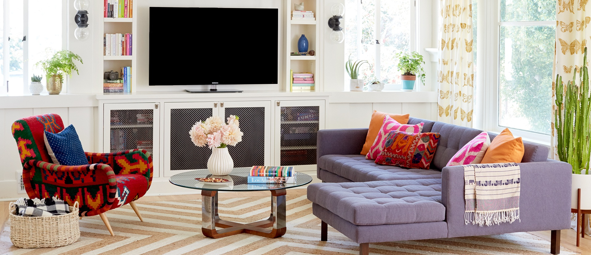 001-echo-park-living-room-hgtv-magazine-feature-anthropologie-kilim-chair-leila-los-angeles-modern-bohemian-bungalow-living-chevron-orange-rug-built-in-media-center-rejuvenation-lighting