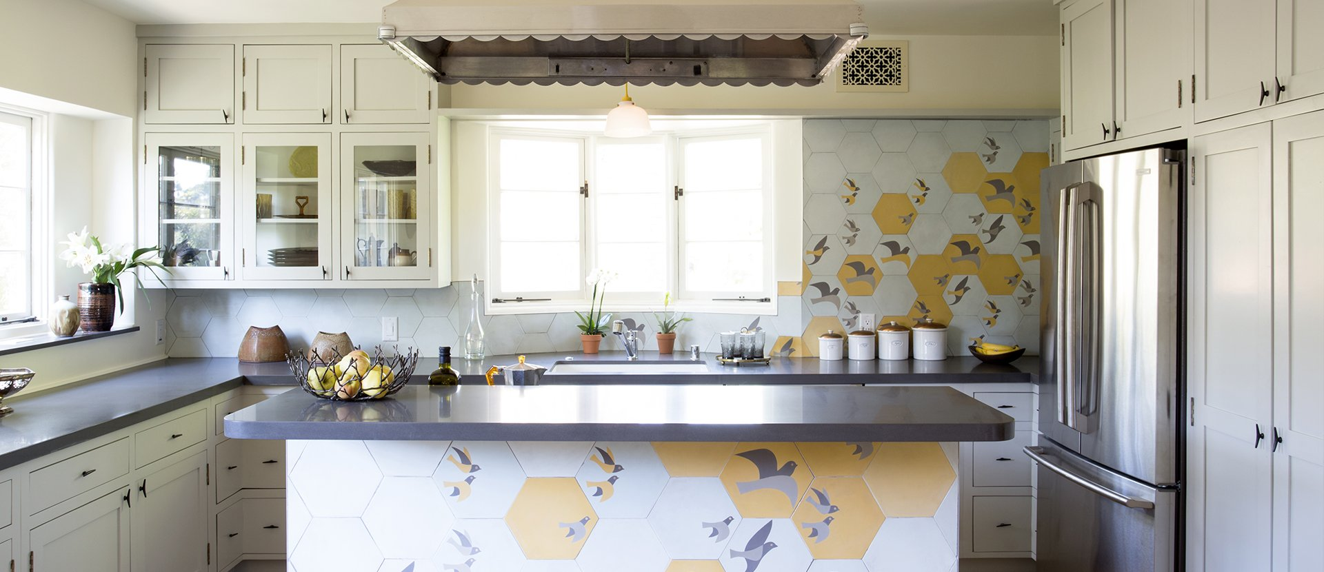 004-panorama-terrace-kitchen-bird-tile-mural-kitchen-island-design-vuelo-cement-hexagon-tile-design-vidal-mystical-journey-collection-custom-hood