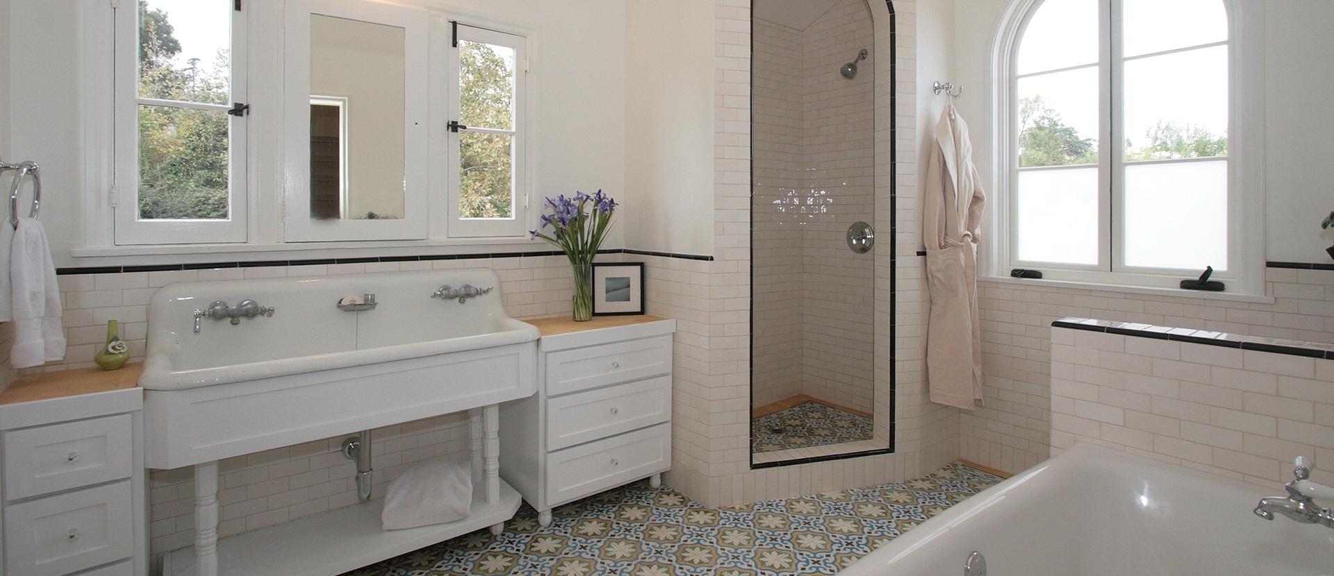 005-los-feliz-bathroom-double-pedestal-sink-cement-tile-custom-cabinets-arched-shower-light-pink-subway-tile