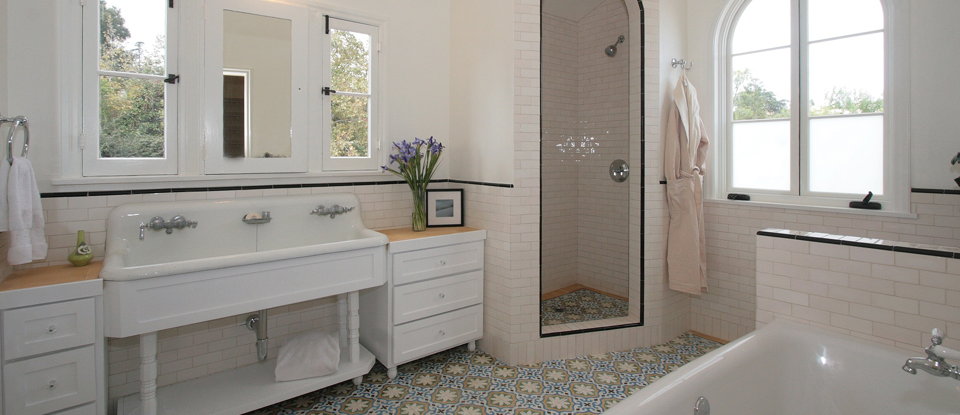 005-los-feliz-bathroom-double-pedestal-sink-cement-tile-custom-cabinets-arched-shower-light-pink-subway-tile